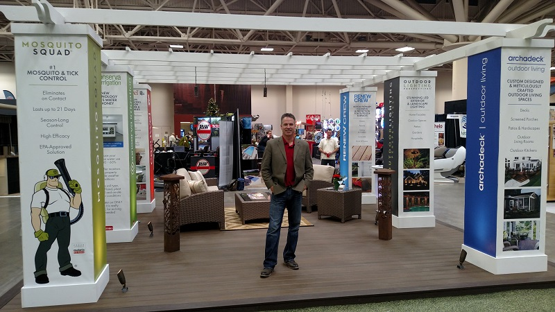 Russ standing in front of OLB convention display